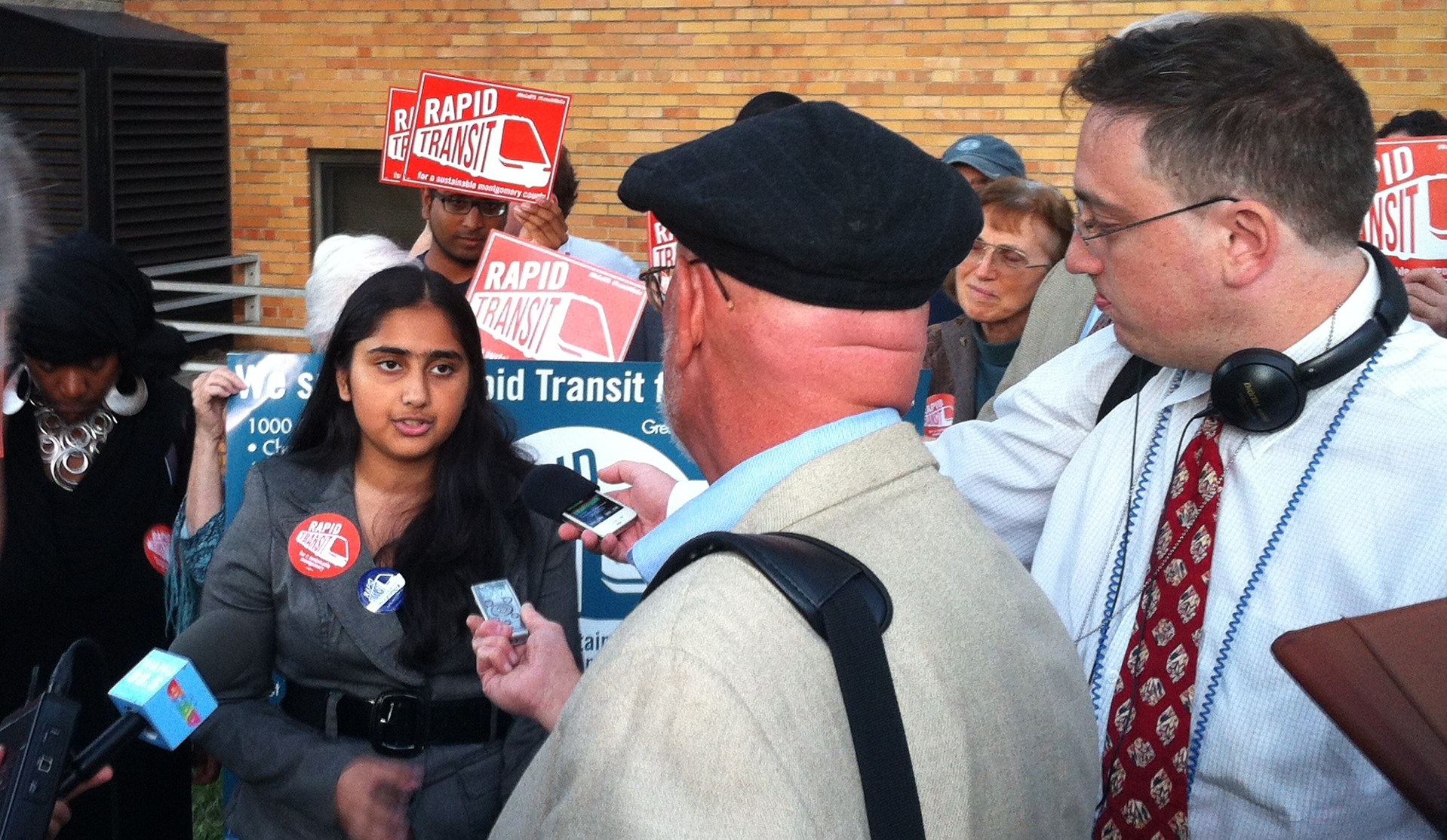 Sarena helps rally the crowd before MCYD testifies in support of Rapid Transit at a County Council Hearing (September 2013)